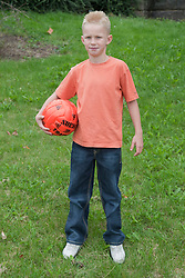 Portrait of white boy with football