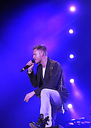 """Westlife Farewell Tour 2012 at the SECC.27-05-12...Nicky Byrne of Irish Super Group Westlife perform during their sell out show at the SECC in the Scottish Leg of their Farewell World Tour. .. Westlife are an Irish boy band formed in 1998. They are to disband in 2012 after their farewell tour. The group's line-up was Shane Filan, Mark Feehily, Kian Egan, and Nicky Byrne. Brian McFadden was part of the group until 2004. Westlife have sold over 45 million records worldwide which includes studio albums, singles, video release, and compilation albums.. Despite the group's worldwide success, they only have one hit single in the United States, """"Swear It Again"""", which peaked in 2000 on the Billboard Hot 100 at number 20. The band were originally signed by Simon Cowell and are managed by Louis Walsh. The group have accumulated 14 number-one singles in the United Kingdom, the third-highest in UK history, tying with Cliff Richard..The group had also broken a few records, including """"Music artist with most consecutive number 1's in the UK"""", which consists of their first seven singles and only behind The Beatles and Elvis Presley..The band have 14 UK number ones and 25 top ten singles, consisting of 20.2 million records and videos in the UK across their 14-year career - 6.8 million singles, 11.9 million albums and 1.5 million videos. The Band are best known for amazing songs such as Flying Without Wings and Safe....At The SECC, Glasgow..Picture  Mark Davison/ ProLens PhotoAgency/ PLPA.Sunday 27th May 2012."""
