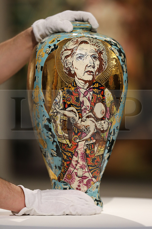 © Licensed to London News Pictures. 07/02/2020. London, UK. A technician adjusts Grayson Perry's ceramic vase tilted 'Love Letters' (£80,000 - £140,000) at the preview of Sotheby's Contemporary Art. The auction will take place at Sotheby's in central London on 11 and 12 February 2020. Photo credit: Dinendra Haria/LNP