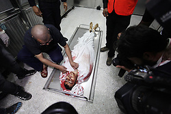 April 27, 2018 - Gaza City, Gaza Strip - The body of a Palestinian man who was shot dead by Israeli security forces during clashes at the Israel-Gaza border, is seen at a hospital in Gaza. (Credit Image: © Mahmoud Ajour/APA Images via ZUMA Wire)