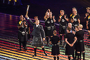 23.07.2014. Glasgow, Scotland. Glasgow Commonwealth Games. Fans ahead of the opening ceremony. Sir Chris Hoy with the Queens Baton