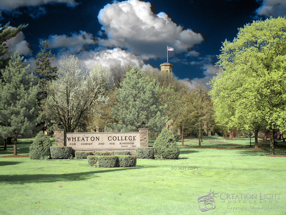 """Wheaton College in Wheaton, IL was founded in 1860.  The college's motto is """"For Christ and His Kingdom.""""   Wheaton's """"Old Main,"""" Blanchard Hall was built in four sections beginning in 1853 and was completed in 1927. Named for Jonathan Blanchard, the College's founder and first president, and his son, Charles Blanchard, the second president, the building is the oldest and most recognized on campus..The building's castle-like architecture was patterned after buildings at Oxford University which Dr. Jonathan Blanchard admired. It is constructed of native Illinois limestone that was quarried in Batavia, Illinois."""