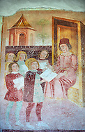 Religious murals depicting the Life of St Antonio Abate by Dionisio Baschenis ( circa 1493) on the exterior of the Gothic Church of San Antonio Abate,  Pelugo, Province of Trento, Italy .<br /> <br /> Visit our ITALY PHOTO COLLECTION for more   photos of Italy to download or buy as prints https://funkystock.photoshelter.com/gallery-collection/2b-Pictures-Images-of-Italy-Photos-of-Italian-Historic-Landmark-Sites/C0000qxA2zGFjd_k<br /> If you prefer to buy from our ALAMY PHOTO LIBRARY  Collection visit : https://www.alamy.com/portfolio/paul-williams-funkystock/san-antonio-abate-pelugo.html .<br /> <br /> Visit our ITALY HISTORIC PLACES PHOTO COLLECTION for more   photos of Italy to download or buy as prints https://funkystock.photoshelter.com/gallery-collection/2b-Pictures-Images-of-Italy-Photos-of-Italian-Historic-Landmark-Sites/C0000qxA2zGFjd_k<br /> .<br /> <br /> Visit our MEDIEVAL PHOTO COLLECTIONS for more   photos  to download or buy as prints https://funkystock.photoshelter.com/gallery-collection/Medieval-Middle-Ages-Historic-Places-Arcaeological-Sites-Pictures-Images-of/C0000B5ZA54_WD0s