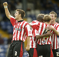 Photo: Aidan Ellis.<br /> Bury FC v Brentford. Coca Cola League 2. 01/09/2007.<br /> Brentford's Grant Basey leads the celebrations after the second goal