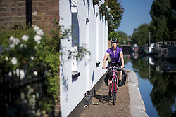 © Licensed to London News Pictures. 23/06/2020. London, UK. A woman cycling along the towpath of Grand Union Canal at Little Venice in central London at the beginning of a warm summers day. Record temperatures are expected this week as the UK starts to relax lockdown restrictions, introduced earlier this year to prevent the spread of COVID-19. Photo credit: Ben Cawthra/LNP