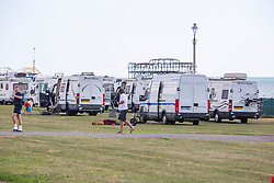 © Licensed to London News Pictures. 01/09/2019. Brighton, UK. Members of the travelling community have pitched their caravans and trailers on the seafront at Hove Lawns in Brighton and Hove. A large number of vehicles arrived overnight and parked on the popular family spot. Photo credit: Hugo Michiels/LNP