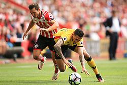 13 August 2016 - Premier League - Southampton v Watford - Jose Holebas of Watford tangles with Cedric Soares of Southampton - Photo: Marc Atkins / Offside.