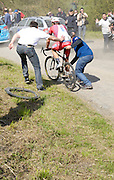 France, April 13th 2014: Team Katusha leader Alexander Kristoff (#61) is pushed off following a wheel change by the Pont Gibus during the 2014 Paris Roubaix cycle race.