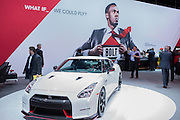 New York, NY - 1 April 2015. The 2016 Nissan GT-R Nismo in front of a display featuring runner Usan Bolt.  The GT-R Nismo is Nissan's premium sportscar, featuring a 600hp turbocharged V6 engine, and with a suggested retail price of over $149,000.