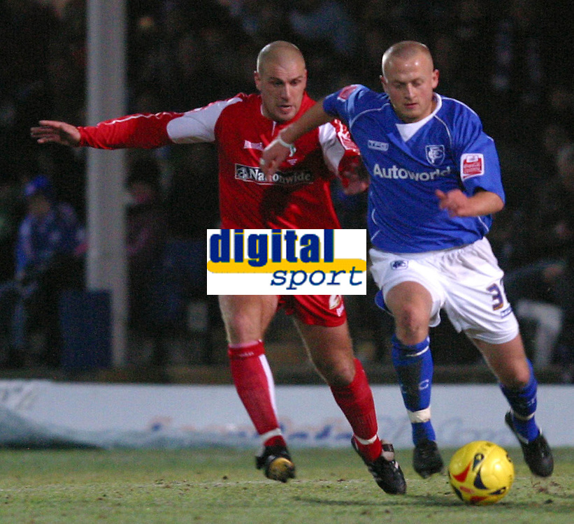 Photo: Dave Linney.<br />Chesterfield v Swindon Town. Coca Cola League 1.<br />28/12/2005.Andy Gurney(Swindon) battles with Sammy Clingan(Chesterfield)