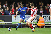 AFC Wimbledon defender Jon Meades (3) crossing the ball during the The FA Cup match between AFC Wimbledon and Lincoln City at the Cherry Red Records Stadium, Kingston, England on 4 November 2017. Photo by Matthew Redman.