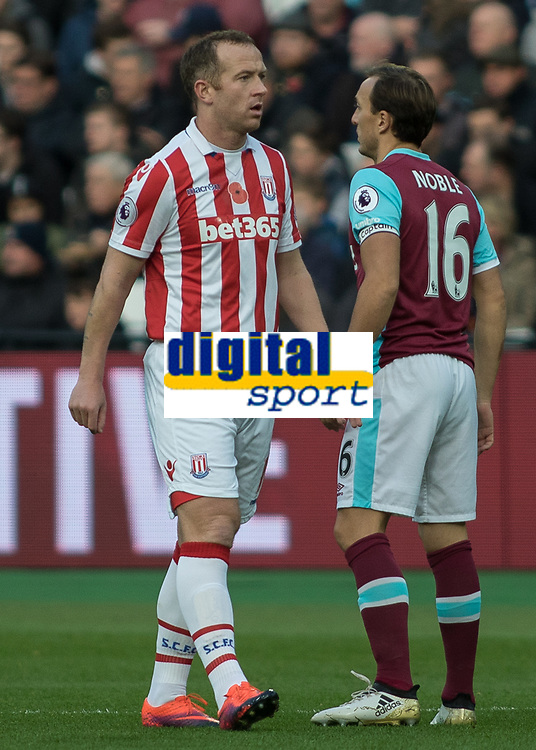 Football - 2016 / 2017 Premier League - West Ham United vs. Stoke City<br /> <br /> Charlie Adam of Stoke City with Mark Noble of West Ham  at The London Stadium.<br /> <br /> COLORSPORT/DANIEL BEARHAM