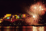 Fireworks celebrate 500 years Christopher Columbus as Calvi illuminates the Citadelle with colored lights and fireworks in this documentary photograph..