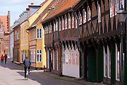 Locals in medieval street in Ribe centre, South Jutland, Denmark