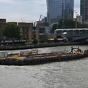 Thames river repair boat on 18 July 2019, City of London, UK.