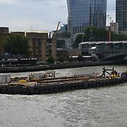 Thames river repair boat on 18 July 2019, City of London, UK.