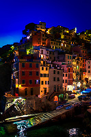 """""""Twilight falls on the village of Riomaggiore""""...<br /> <br /> I began my daily journey at the northern most town of Monterosso and took the train to the southernmost town of Riomaggiore. Upon arriving in this picturesque seaside village and moving down to the water's edge, I noticed proprietor Francesco in front of a tiny boat rental sign.  After arranging an evening sail up the coast, I was able to focus on the colorful persona of Riomaggiore. That evening I sailed up the coast photographing each Cinque Terre town along the way aboard the Angelina Dada. Upon arriving back home in Monterosso, soft light illuminated the sky and azure sea of the Mediterranean convincing me to sail all the way back to Riomaggiore with my gracious guides Claudio and Eddie of """"Cinque Terre dal Mare"""" sailing excursions. We arrived just in time for a perfect sunset and a perfect evening for creating bellissimo new images. After a nice dinner...I caught the last train at midnight back home to Monterosso. A very long day, but worth every minute!"""