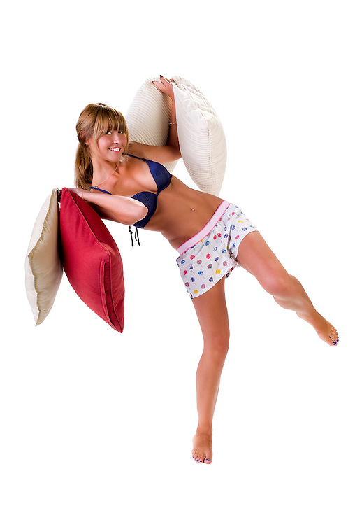 Young woman very playful in pajamas and laughing.
