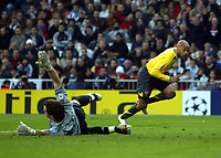 Photo: Chris Ratcliffe.<br />Real Madrid v Arsenal. UEFA Champions League. 2nd Round, 1st Leg. 21/02/2006.<br />Thierry Henry of Arsenal scoring the first goal past a sprawling Iker Casillas of Madrid.