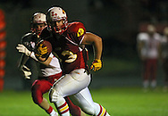 Marion's Trev Biery (33) runs 15 yards for a touchdown during the first half of the game between Maquoketa and Marion at Thomas Park Field in Marion on Friday, September 21, 2012.
