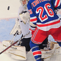Pittsburgh Penguins goalie Marc-Andre Fleury (29) catches a rebound with New York Rangers left wing Ruslan Fedotenko (26) on the doorstep during second period NHL action between the Pittsburgh Penguins and the New York Rangers at Madison Square Garden.