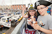 06/07/2012.Laura and Sam Chapole from Carnmore Galway enjoying an ice-cream at the Volvo Ocean Race in Galway Docks.Photo:Andrew Downes