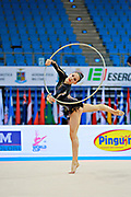 Berezina Polina during qualifying at hoop in Pesaro World Cup 10 April 2015.<br /> Polina Berezina is a Spanish individual rhythmic gymnast of Russian origin was born in Moscow in Russia on December 5, 1997, she has been living in Spain near Alicante for some years, her team is Club Torrevieja and she is coached by Mónica Ferrández.