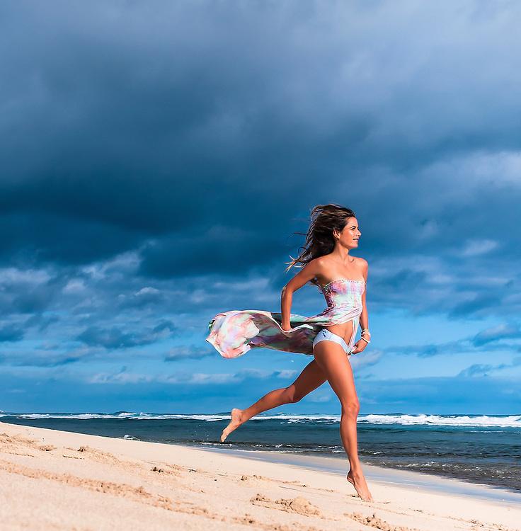 Woman on the beach in Hawaii wearing the Tiare Hawaii Over the Rainbow Dress. <br /> www.tiarehawaii.com<br /> Model Andrea Hannemann