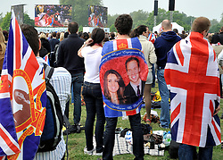 © under license to London News Pictures. LONDON, UK  28/04/2011. The Royal Wedding of HRH Prince William to Kate Middleton.  People watch the wedding on giant screens in Hyde Park, London. Photo credit should read Stephen Simpson/LNP.