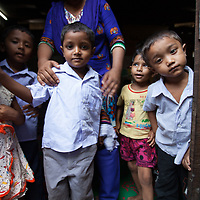 Children at a small school in the Outfall Slum, Dhaka, Bangladesh