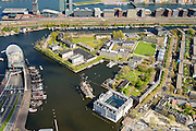 Nederland, Noord-Holland, Amsterdam, 09-04-2014;<br /> Het Marineterrein, Kattenburg en het Scheepvaartmuseum, links de IJtunnel en museum Nemo met historische woonboten. Boven het IJ, Java-eiland en de Piet Heinkade, spoorbaan.<br /> Navy area (center) and the National Maritime Museum (white building), left Museum Nemo, railroad, newly constructed buildings.  Top right the North of Amsterdam. <br /> luchtfoto (toeslag op standard tarieven);<br /> aerial photo (additional fee required);<br /> copyright foto/photo Siebe Swart
