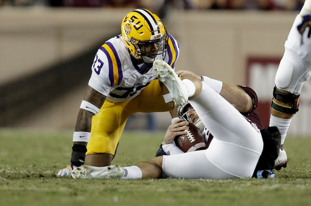 Texas A&M quarterback Trevor Knight (8) is sacked by LSU safety Jamal Adams (33) during the first quarter of an NCAA college football game Thursday, Nov. 24, 2016, in College Station, Texas. (Sam Craft/The Eagle)
