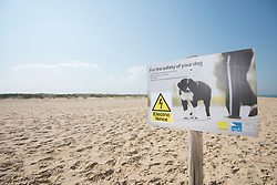 Dog walking interpretation sign, Little tern Sternula albifrons monitoring site, part of an EU Life Project to protect this species, Winterton-on-Sea, Norfolk, July
