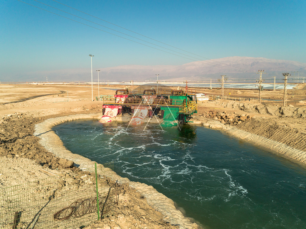 Aerial view of three water pump in different color pumping water, Dead Sea, Negev, Israel.