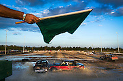 DAVID ALBERS/STAFF<br /> - Demolition derby racers compete in an 10-lap enduro race at the Collier County Fair on Saturday, March 15, 2014.