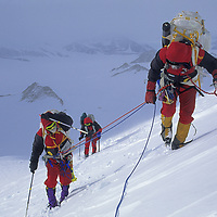 ANTARCTICA, Vern Tejas guides Norman Vaughan (88) & wife Carolyn up mountain named for Norman in 1929 by Admiral  Byrd.  (MR)