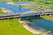 Nederland, Utrecht, Gemeente Vianen, 13-05-2019; Ruimte voor Rivier (Ruimte voor de Lek), bij Vianen. Uiterwaardvergraving Bossenwaard, Pontwaard en Heerenwaard, inclusief aanleg nevengeulen en zomerkades. Door de rivierverruiming kan bij hoog water, mede een gevolg van klimaatveranderingen, het water sneller afgevoerd. Lekbrug Vianen (Jan Blankenbrug) in de achtergrond.<br /> Floodplain excavation, including construction of side channels, because of climate change, in order to guarantee quicker drain off.<br /> luchtfoto (toeslag op standard tarieven);<br /> aerial photo (additional fee required);<br /> copyright foto/photo Siebe Swart