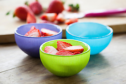 Coloured bowls with strawberries