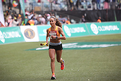 10062018 (Durban) A 3rd position Alexandra Morozova, Russia (6:20:21) run towards the finnish line during the 2018 Comrades marathon in Durban.<br /> Picture: Motshwari Mofokeng/ANA