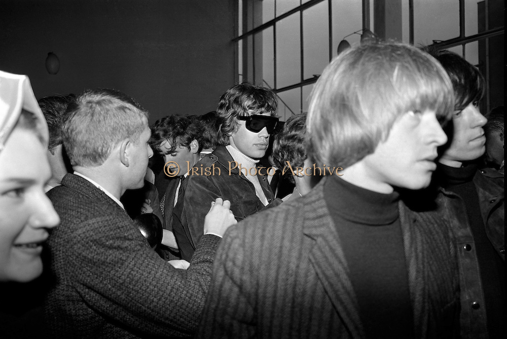 The Rolling Stones Charlie is my Darling - Ireland 1965 -..Fans ask Mick Jagger and Brian Jones of The Rolling Stones for autographs in Dublin Airport before their performance at the Adelphi Theatre, Middle Abbey Street, Dublin. This was the band's second Irish tour of 1965.....03/09/1965..09/03/1965..03 September 1965...The Rolling Stones Charlie is my Darling - Ireland 1965.Out November 2nd from ABKCO.Super Deluxe Box Set/Blu-ray and DVD Details Revealed. .ABKCO Films is proud to join in the celebration of the Rolling Stones 50th Anniversary by announcing exclusive details of the release of the legendary, but never before officially released film, The Rolling Stones Charlie is my Darling - Ireland 1965.  The film marked the cinematic debut of the band, and will be released in Super Deluxe Box Set, Blu-ray and DVD configurations on November 2nd (5th in UK & 6th in North America).. .The Rolling Stones Charlie is my Darling - Ireland 1965 was shot on a quick weekend tour of Ireland just weeks after ?(I Can't Get No) Satisfaction? hit # 1 on the charts and became the international anthem for an entire generation.  Charlie is my Darling is an intimate, behind-the-scenes diary of life on the road with the young Rolling Stones featuring the first professionally filmed concert performances of the band's long and storied touring career, documenting the early frenzy of their fans and the riots their live performances incited.. .Charlie is my Darling showcases dramatic concert footage - including electrifying performances of ?The Last Time,? ?Time Is On My Side? and the first ever concert performance of the Stones counterculture classic, ?(I Can't Get No) Satisfaction.?  Candid, off-the-cuff interviews are juxtaposed with revealing, comical scenes of the band goofing around with each other. It's also an insider's glimpse into the band's developing musical style by blending blues, R&B and rock-n-roll riffs, and the film captures the spark about to combust into The Greatest Ro