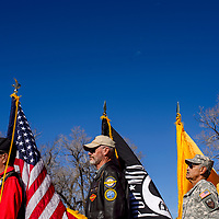 Edward Kline, left, Mark Kasehagen and Tony Griego post the colors for a ceremonial flag retiring in Thoreau Friday.