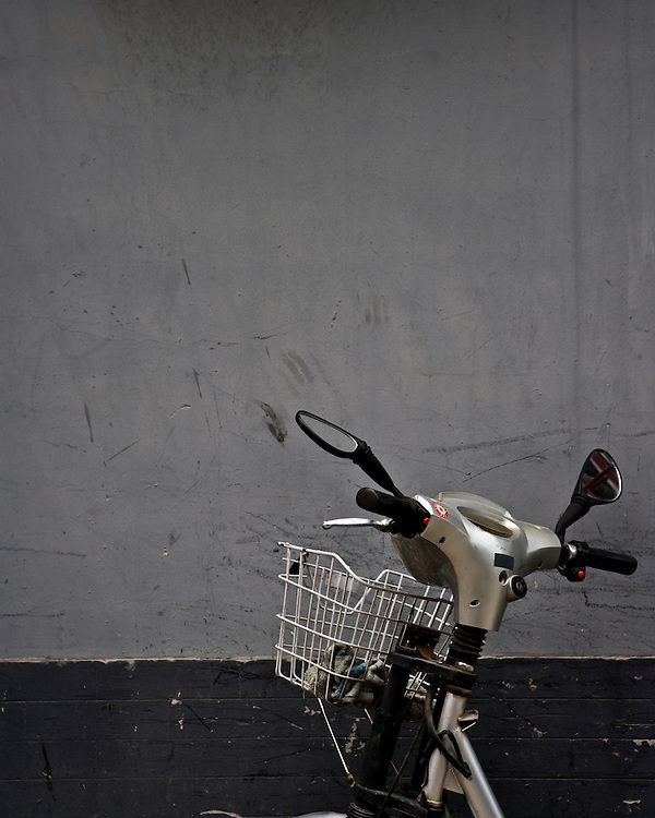 Handlebars of a moped , Mirrors and Basket