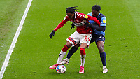 Middlesbrough's Djed Spence shields the ball from Wycombe Wanderers' Fred Onyedinma<br /> <br /> Photographer Alex Dodd/CameraSport<br /> <br /> The EFL Sky Bet Championship - Middlesbrough v Wycombe Wanderers - Saturday 8th May 2021 - Riverside Stadium - Middlesbrough<br /> <br /> World Copyright © 2021 CameraSport. All rights reserved. 43 Linden Ave. Countesthorpe. Leicester. England. LE8 5PG - Tel: +44 (0) 116 277 4147 - admin@camerasport.com - www.camerasport.com