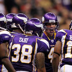 September 9, 2010; New Orleans, LA, USA; Minnesota Vikings quarterback Brett Favre (4) talks to teammates in the huddle during the third quarter of the NFL Kickoff season opener against the New Orleans Saints at the Louisiana Superdome. Mandatory Credit: Derick E. Hingle