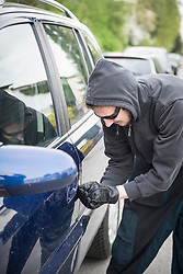 Thief unlocking car door