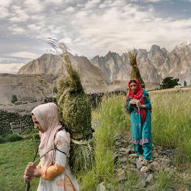 Men and women's chores are often interchangeable in Wakhi culture. Here, a mother and daughter from Hussaini village walk to their summer pastures to collect fodder for their animals.