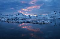 Winter sunset over mountain of Moskenesøy from Fredvang bridges, Lofoten Islands, Norway