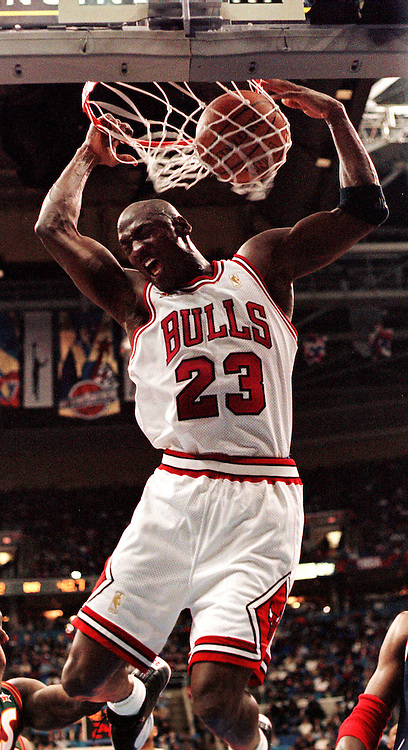 1997 NBA All-Star game -- Chicago's Michael Jordan slam dunks in the first half. Jordan got the first triple double in the history of the NBA All-Star game..