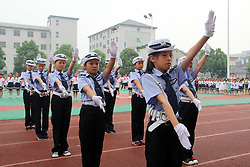 June 1, 2017 - Hangzhou, Hangzhou, China - Hangzhou, CHINA-June 1 2017: (EDITORIAL USE ONLY. CHINA OUT)..Girls wearing traffic  police uniform learn to  take command of the traffic  at a primary school in Hangzhou, east China's Zhejiang Province, June 1st,2017. (Credit Image: © SIPA Asia via ZUMA Wire)
