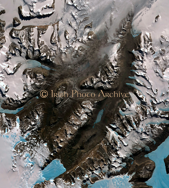 The McMurdo Dry Valleys are a row of valleys west of McMurdo Sound, Antarctica. They are so named because of their extremely low humidity and lack of snow and ice cover. December 8, 2002. Satellite image.